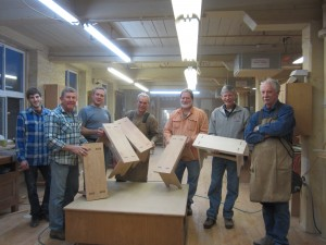 1st Avenue Woodworking registrants show off their completed projects created in Ed Schoen's furniture making class.