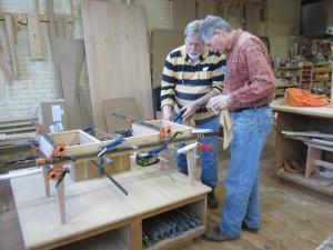 Ed Schoen demonstrates woodworking techniques in his furniture making class at his 1st Avenue Woodworking Studio.