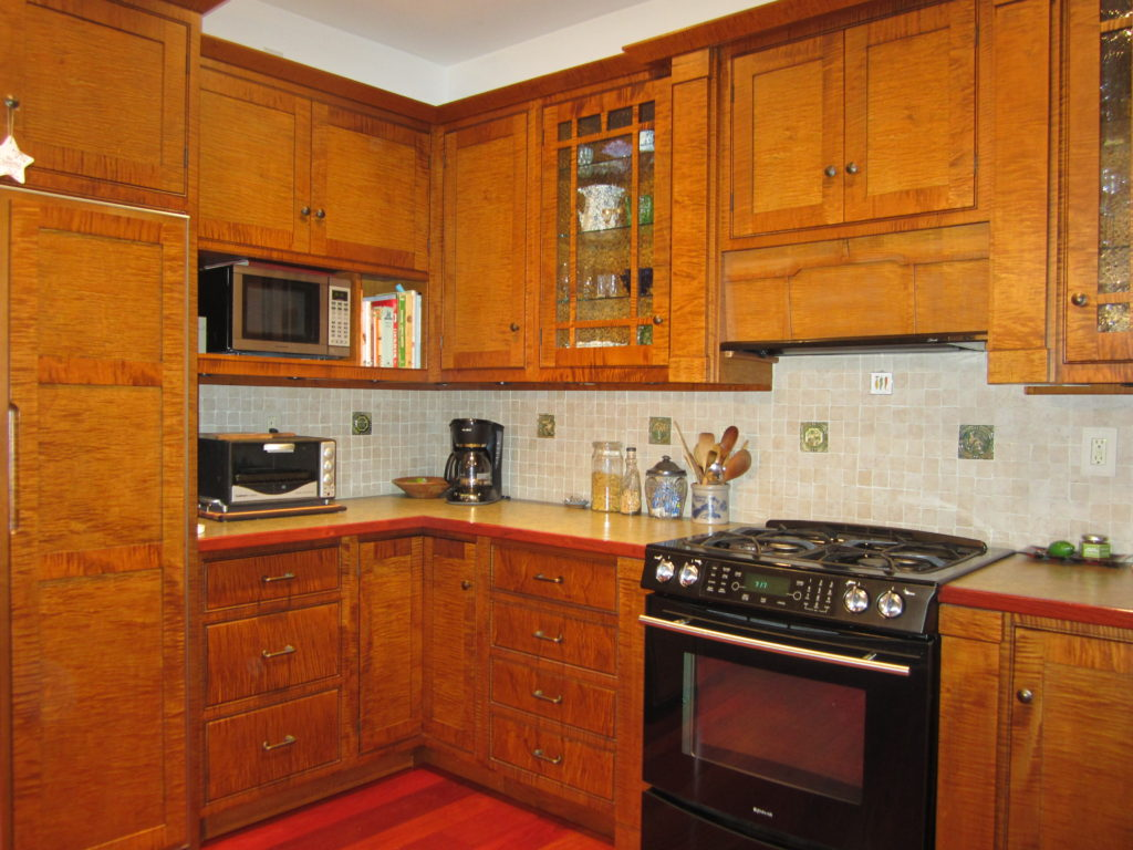 Beautiful custom cabinetry is shown. Build your own cabinet in this woodworking course.
