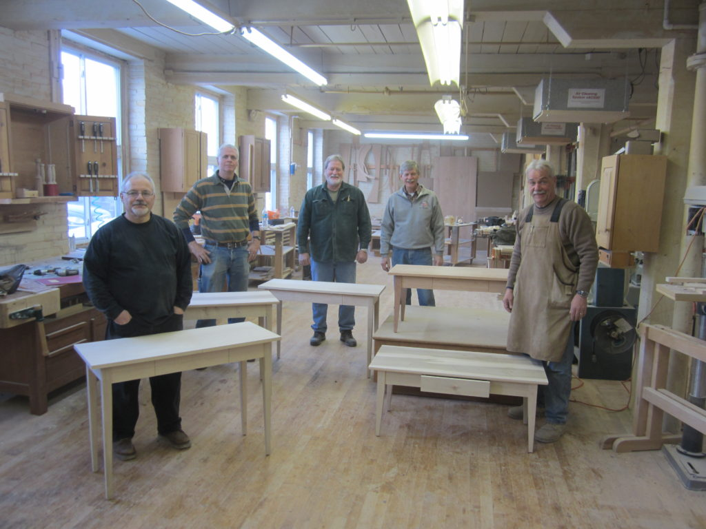 Our Furniture and Cabinetmaking 2 attendees show off their finished projects: their very own console tables.